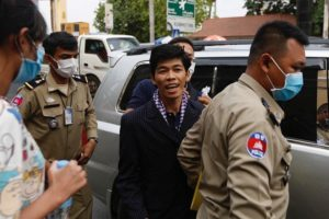 Sovann Rithy arrives at the Phnom Penh Municipal Court escorted by police in April 2020. Photo courtesy of CamboJA.